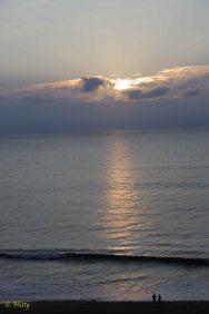 Two folks at the beach enjoying the sunrise!